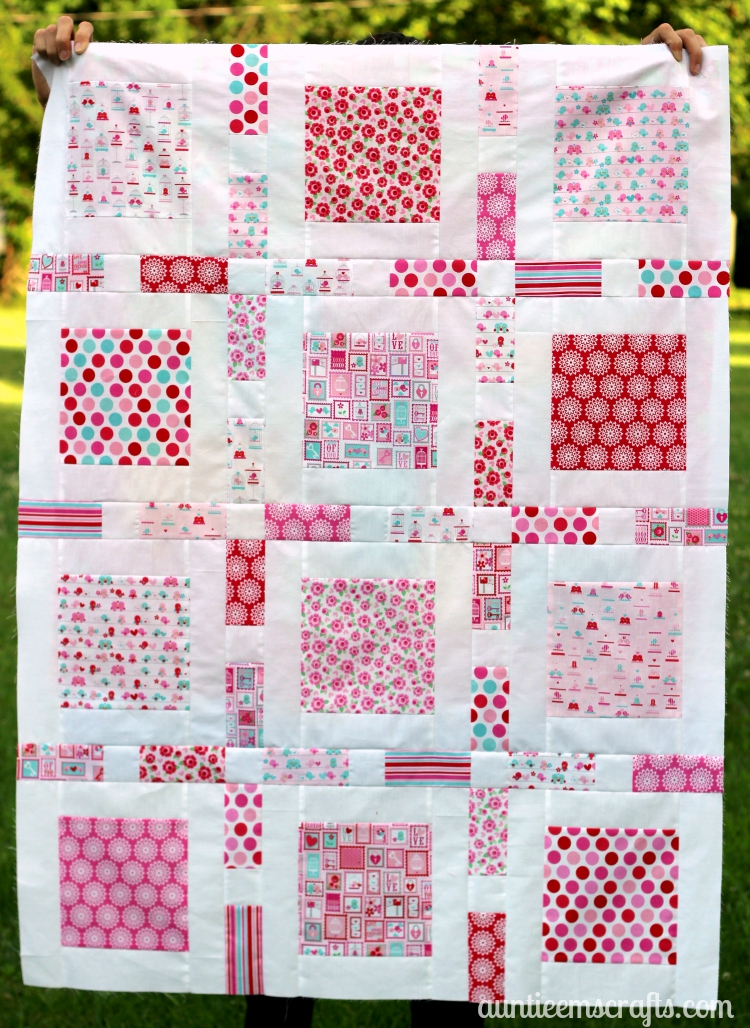 Lovey Dovey Baby Quilt on AuntieEmsCrafts.com. Riley Blake Lovey Dovey fabrics in a small Framed pattern by Camille Roskelley. Love it!
